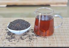 Teapot and black tea. Tea  set on the bamboo cushion Royalty Free Stock Photos