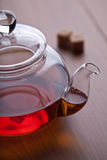 Teapot with black tea and sugar cubes Royalty Free Stock Photos