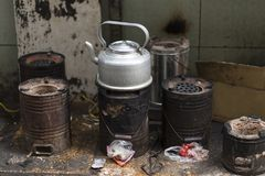 Teapot boiling on rustic stoves in the streets of Hanoi, Vietnam royalty free stock image