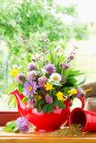 Teapot with bouquet of healing herbs and flowers royalty free stock image
