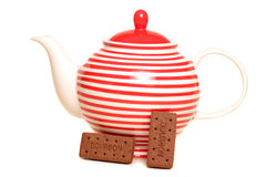 Teapot and bourbon biscuits Stock Photos