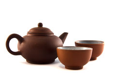Teapot  brown. Teapot and two cups of tea leaves into clay Stock Image