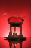 Teapot and the candle Stock Image