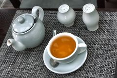 Teapot and cap of tea Stock Photos