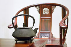 Teapot and chair Royalty Free Stock Photos