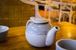 A Teapot on China Local Restaurant Dining Table royalty free stock images