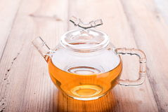 Teapot with Chinese green tea on the table Stock Photo