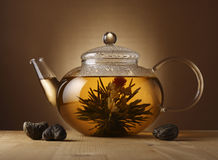 Teapot with Chinese tea. A glass teapot with Lotus Flower Chinese tea Stock Photography