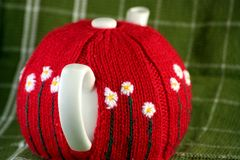 Teapot with cozy on Royalty Free Stock Photo