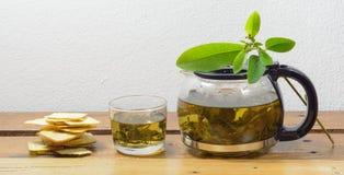 Teapot and cracker Royalty Free Stock Photos