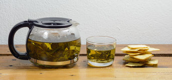 Teapot and cracker Royalty Free Stock Photography