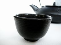 Teapot and Cup. This type of  is also used for Sake royalty free stock photo