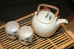Teapot and cup. Near racket teapot and cup Stock Image