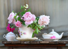 Teapot, cup and beautiful spring bouquet Stock Image