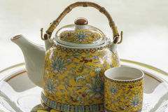 Teapot with cup. Ceramic tableware for tea Royalty Free Stock Photography
