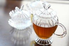 Teapot with cup Stock Photos