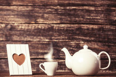 Teapot and cup of coffee Royalty Free Stock Images