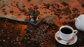 Teapot and cup coffee on saucer with cinnamon and anise stock footage