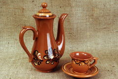 Teapot and cup. Coffee set from clay with a picture Stock Photo