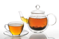Teapot and cup with green tea. On a white background Stock Images