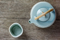Teapot and cup of herbal tea Royalty Free Stock Photo