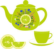Teapot with cup, herbs and lime Royalty Free Stock Photo