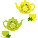 Teapot and cup with herbs, mint, lemon and lime Royalty Free Stock Image