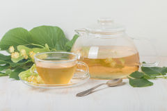Teapot and cup with linden tea Royalty Free Stock Photos