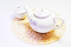 Teapot and cup on the mat Royalty Free Stock Photography