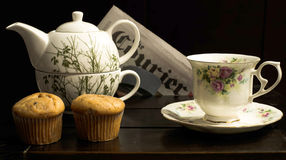 Teapot, cup and muffins Royalty Free Stock Images