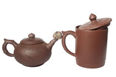 Teapot, cup and rolled dry teaball Royalty Free Stock Photos