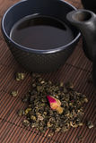 Teapot and cup with rose Stock Image