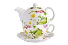 Teapot, cup and saucer. Against white background Royalty Free Stock Images