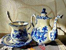 Teapot, cup with saucer and teaspoon. Things in Russian traditional Gzhel style. Gzhel - Russian folk craft of ceramics Royalty Free Stock Images