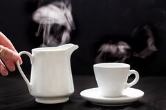Teapot and cup with smoke