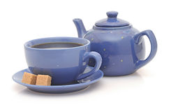 Teapot, cup and sugar Stock Images