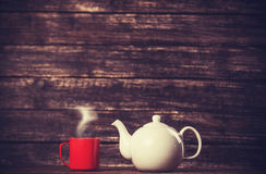 Teapot and cup of tea Stock Photo