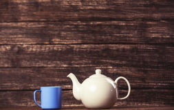 Teapot and cup of tea Stock Images