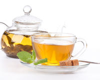 Teapot and cup of tea  with mint. Royalty Free Stock Photos
