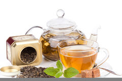 Teapot and cup of tea  with mint. Stock Photo