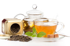 Teapot and cup of tea  with mint. Royalty Free Stock Photography