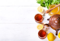 Teapot and cup of tea with mint and lemon Stock Photo