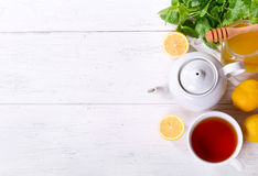 Teapot and cup of tea with mint and lemon Stock Photography