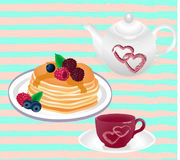 Teapot and cup of tea and pancake with bererry Stock Image