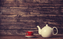 Teapot and cup of tea. On wooden table royalty free stock image