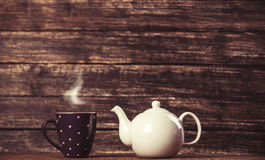 Teapot and cup of tea royalty free stock photos