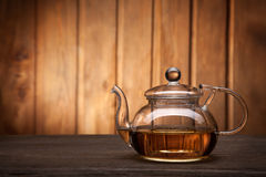 Teapot and cup of tea on wooden table Royalty Free Stock Image