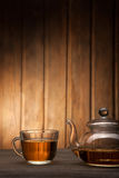 Teapot and cup of tea on wooden table Stock Photo