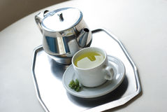 Teapot and a cup on a tray Stock Images