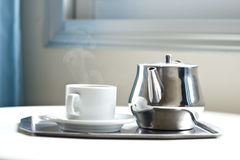 Teapot and a cup on a tray Stock Photography